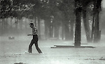 A man wades through the storm surge of Hurricane Kate in Apalachicola, Florida November 21, 1985.  Kate, a late November Hurricane,  was latest forming Atlantic hurricane on record at the time and was the second for the area following Hurricane Elena two months earlier.