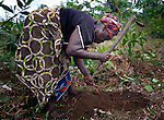 "Vabrah Weekie, 54, works with several dozen women to grow cassava on a six-acre farm in Mount Barclay, Liberia. The income-generating project, called ""Say No to Poverty,"" is administered by the National Federation of Women Employees and Allied Workers, with financial support from United Methodist Women."
