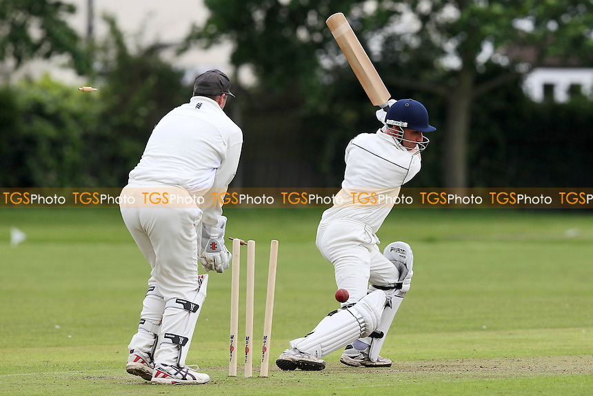 D Waller of Leigh is bowled out by M Bhad - Gidea Park & Romford CC vs Leigh-on-Sea CC - Essex Cricket League at Gallows Corner - 16/06/12 - MANDATORY CREDIT: Gavin Ellis/TGSPHOTO - Self billing applies where appropriate - 0845 094 6026 - contact@tgsphoto.co.uk - NO UNPAID USE.