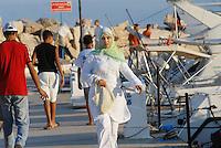 - young woman takes a walk in the tourist port of Sidi Bou Said ....- giovane donna passeggia nel porto turistico di Sidi Bou Said