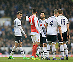 Tottenham's Dele Alli and Mousa Dembele argue with Arsenal's Olivier Giroud<br /> <br /> - English Premier League - Tottenham Hotspur vs Arsenal  - White Hart Lane - London - England - 5th March 2016 - Pic David Klein/Sportimage