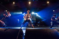 Die Hardcore Punkband Propagandhi aus Winipeg/Kanada spielte am Sonntag den 4. November 2018 im Berliner Club Astra.<br /> Im Bild vlnr.: Bassist Todd Kowalski; Gruendungsmitglied, Gitarrist und Saenger Chris Hannah und Gitarristin Sulynn Hago.<br /> 4.11.2018, Berlin<br /> Copyright: Christian-Ditsch.de<br /> [Inhaltsveraendernde Manipulation des Fotos nur nach ausdruecklicher Genehmigung des Fotografen. Vereinbarungen ueber Abtretung von Persoenlichkeitsrechten/Model Release der abgebildeten Person/Personen liegen nicht vor. NO MODEL RELEASE! Nur fuer Redaktionelle Zwecke. Don't publish without copyright Christian-Ditsch.de, Veroeffentlichung nur mit Fotografennennung, sowie gegen Honorar, MwSt. und Beleg. Konto: I N G - D i B a, IBAN DE58500105175400192269, BIC INGDDEFFXXX, Kontakt: post@christian-ditsch.de<br /> Bei der Bearbeitung der Dateiinformationen darf die Urheberkennzeichnung in den EXIF- und  IPTC-Daten nicht entfernt werden, diese sind in digitalen Medien nach §95c UrhG rechtlich geschuetzt. Der Urhebervermerk wird gemaess §13 UrhG verlangt.]