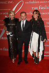 Left to right Amanda Parks, Burak Cakmak and Julie Gilhart arrive at The Fashion Group International's Night of Stars 2017 gala at Cipriani Wall Street on October 26, 2017.