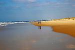 People walking sandy beach coast at El Palmar, near Vejer de la Frontera, Cadiz Province, Spain