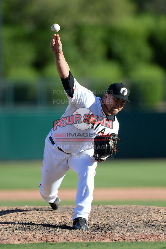 Glendale Desert Dogs pitcher Colby Suggs (43), of the Miami Marlins organization, during an Arizona Fall League game against the Mesa Solar Sox on October 8, 2013 at Camelback Ranch Stadium in Glendale, Arizona.  The game ended in an 8-8 tie after 11 innings.  (Mike Janes/Four Seam Images)