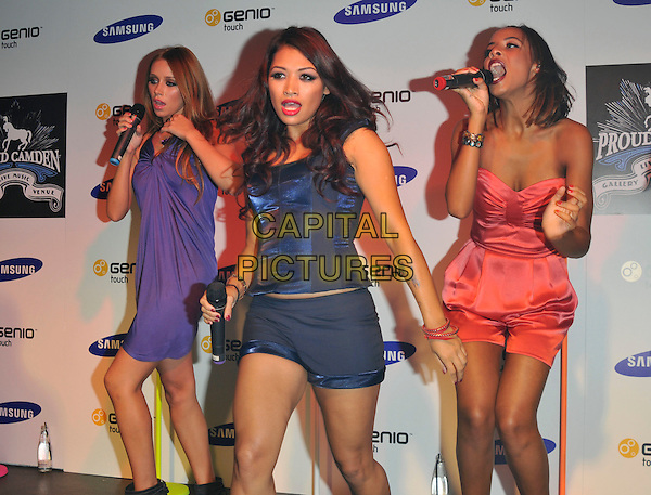THE SATURDAYS - Una Healy, Vanessa White & Rochelle Wiseman.Launch of the new mobile phone Samsung Genio Touch at Proud Camden, London, England..September 14th, 2009.stage concert live gig performance music full length purple dress black short playsuit pink coral dancing singing blue mouth open corset .CAP/PL.©Phil Loftus/Capital Pictures.
