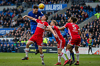 Sean Morrison of Cardiff City heads at goal under pressure from Daniel Ayala of Middlesbrough during the Sky Bet Championship match between Cardiff City and Middlesbrough at the Cardiff City Stadium, Cardiff, Wales on 17 February 2018. Photo by Mark Hawkins / PRiME Media Images.