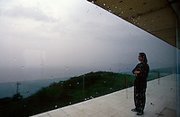 Architect Shoei Yoh stands on the balcony of his house, contemplating the view over the historic Itoshima peninsula
