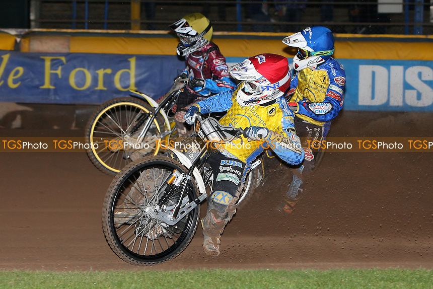 Heat 2: Cameron Woodward (red), Timo Lahti (blue) and Kim Nilsson - Eastbourne Eagles vs Lakeside Hammers - Elite League Speedway Play-Off Semi-Final 2nd Leg at Arlington Stadium - 26/09/11 - MANDATORY CREDIT: Gavin Ellis/TGSPHOTO - Self billing applies where appropriate - 0845 094 6026 - contact@tgsphoto.co.uk - NO UNPAID USE.