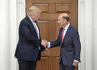 United States President-elect Donald Trump (L) shakes hands with investor Wilbur Ross at the clubhouse of Trump International Golf Club, in Bedminster Township, New Jersey, USA, 20 November 2016.<br /> Credit: Peter Foley / Pool via CNP /MediaPunch