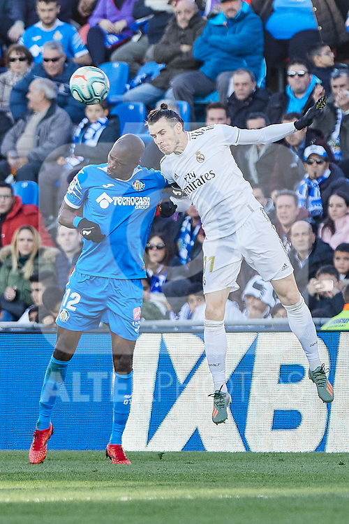 Allan-Romeo Nyom of Getafe FC and Gareth Bale of Real Madrid during La Liga match between Getafe CF and Real Madrid at Coliseum Alfonso Perez in Getafe, Spain. January 04, 2020. (ALTERPHOTOS/A. Perez Meca)