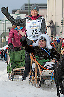 Becca Moore and team leave the ceremonial start line with an Iditarider at 4th Avenue and D Street in downtown Anchorage, Alaska on Saturday, March 5th during the 2016 Iditarod race. Photo by Joshua Borough/SchultzPhoto.com