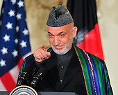 President Hamid Karzai of Afghanistan calls on a reporter as he conducts a joint press conference with United States President Barack Obama (not pictured) in the East Room of the White House in Washington, DC on Wednesday, May 12, 2010..Credit: Ron Sachs / CNP