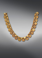 Mycenaean gold necklace with waz lily shaped beads from the Mycenaean cemetery of Midea tomb 10, Dendra, Greece. National Archaeological Museum Athens Cat no 8748.  Grey Background