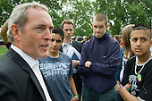 Secretary of State for Work and Pensions John Hutton MP talks to teenagers from deprived communities during a DWP press call outside the Houses of Parliament, Westminster.