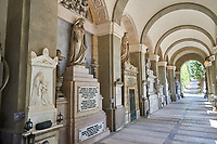 Pictures of the stone sculptured monumental tombs of the lower arcade of the Staglieno Monumental Cemetery, Genoa, Italy