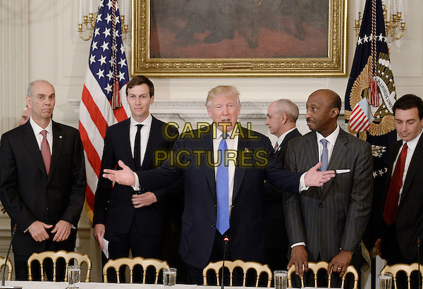 United States President Donald Trump (C) speaks as Juan Luciano (L) Chairman/President/CEO at Archer-Daniels-Midland Co, Jared Kushner, White House Senior Adviser, Kenneth Frazier Chairman and CEO, Merck  and Ford Motor CEO Mark Fields(R) look on during a  listening session with manufacturing CEOs  in the State Dining Room  of the White House on February 23, 2017 in Washington, DC. <br /> CAP/MPI/CNP/RS<br /> &copy;RS/CNP/MPI/Capital Pictures
