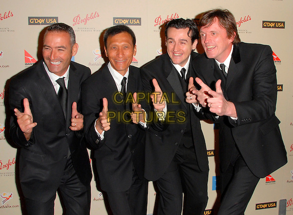 GUESTS.attend The G Day USA: Australia Week 2007 Penfolds Icon Black Tie Gala held at The Hyatt Regency Century Plaza in Century City, California, USA, January 13th 2007..half length black suits funny hands pose.CAP/DVS .©Debbie VanStory/Capital Pictures