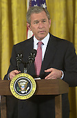 United States President George W. Bush makes remarks at a reception celebrating the 50th Anniversary of the National Day of Prayer in the East Room at the White House in Washington, D.C. on May 3, 2001..Credit: Ron Sachs / CNP