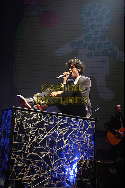 MIKA (Michael Holbrook Penniman Jr.).Performing live at the Hammersmith Apollo, London, England..February 28th, 2010.stage concert live gig performance music full length black jeans denim grey gray jacket piano sitting microphone white shirt singing .CAP/MAR.© Martin Harris/Capital Pictures.