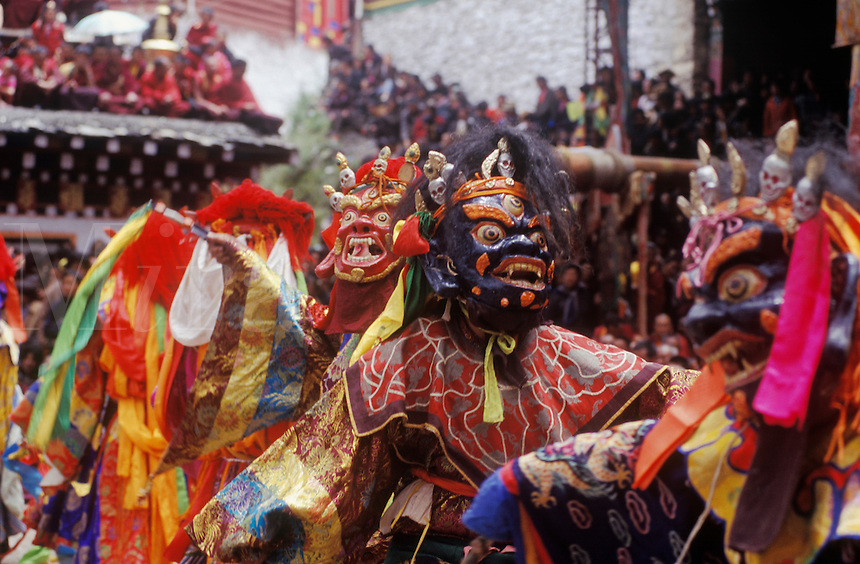 Masked dancers (protector deities) at the Monlam Chenmo or Cham Dances, Katok Monastery - Kham, (Tibet), Sichuan, China
