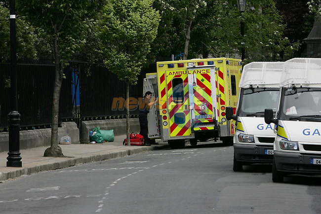 Dublin Ireland..An Ambulance pulls up outside St Patricks Cathedral Church of Ireland in Dublin where 43 Afghan refugees are held up on hungerstrike. Seven day on and there has been on change in the Irish Gevernment stance on  there aylum. As the refugees are taken to hospital they are not allowed to return into the cathedral. 20/5/06..Photo NEWSFILE/FRAN CAFFREY..(Photo credit should read FRAN CAFFREY/NEWSFILE)...This Picture has been sent you under the condtions enclosed by:.Newsfile Ltd..the Studio,.Millmount Abbey,.Drogheda,.Co Meath..Ireland..Tel: +353(0)41-9871240.Fax: +353(0)41-9871260.GSM: +353(0)86-2500958.email: pictures@newsfile.ie.www.newsfile.ie.FTP: 193.120.102.198..This picture is from Fran Caffrey@newsfile.ie