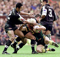 Picture by Shaun Flannery\SWpix.com - 25/11/00 - Rugby League World Cup Final 2000 - Australia v New Zealand, Old Trafford, Manchester, England - Australia's Mat Rogers is brought down by New Zealand.