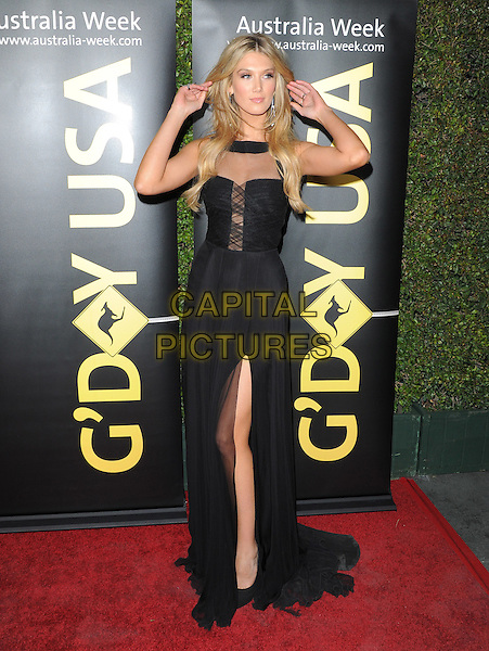 Delta Goodrem.The G'Day USA Australia Week 2012 Black Tie Gala at Hollywood & Highland Grand Ballroom in Hollywood, California, USA..January 14th, 2011.full length black dress slit split sheer hands arms.CAP/RKE/DVS.©DVS/RockinExposures/Capital Pictures.