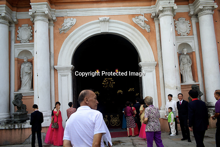 Religious Catholics seen outside the 400 year old St. Augustin church in the walled city of Intramuros in Manila, Philippines. Photo: Sanjit Das