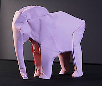 New York, NY, USA - June 22, 2012: An origami creation on display at the OrigamiUSA 2012 convention exhibition held at Fashion Institute of Technology in New York City. This Origami elephant was designed and folded out of one sheet of square paper by Sipho Mabona, an Origami artist living in Switzerland. Mabona was a guest of honor at the convention.