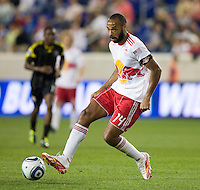 Thierry Henry (14) of the New York Red Bulls pass the ball off during the game at Red Bull Arena in Harrison, NJ.  The New York Red Bulls tied the Columbus Crew, 1-1.