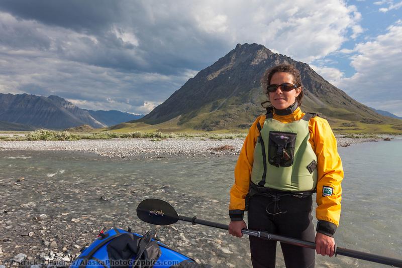 Ali Blechman and pack raft, Marsh Fork of the Canning river in the Arctic National Wildlife Refuge, Brooks range mountains, Alaska.