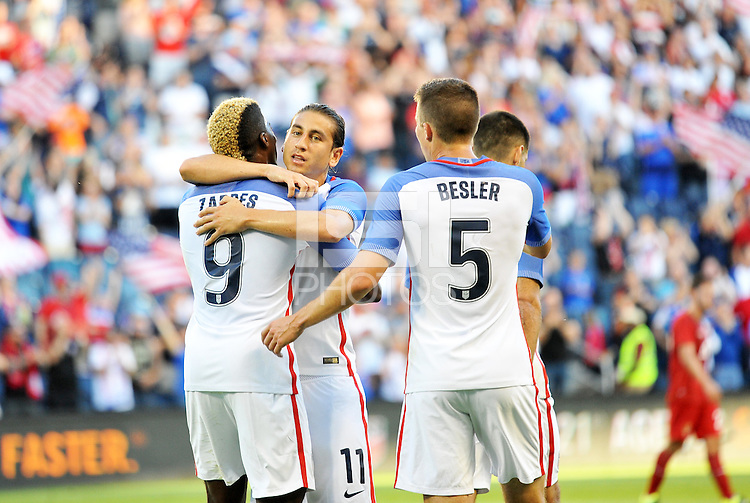 Kansas City, KS. - May 28, 2016:Players congratulate Gyasi Zardes on his opening goal. The U.S. Men's national team defeated Bolivia 4-0 in an international friendly tuneup match prior to the opening of the 2016 Copa America Centenario at Children's Mercy Park.