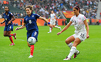 Alex Morgan (r) of team USA scores 3:1 against Sonia Bompastor of team France during the FIFA Women's World Cup at the FIFA Stadium in Moenchengladbach, Germany on July 13th, 2011.