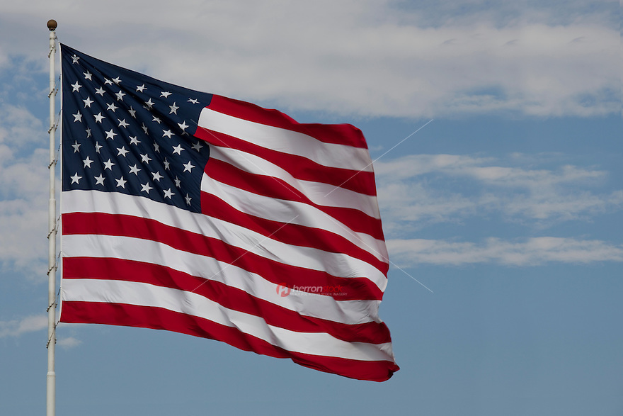 American Flag, proud Stars and Stripes waving in blue sky in Austin, Texas