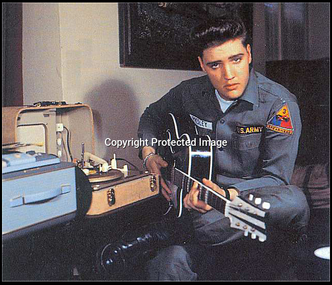 BNPS.co.uk (01202 558833)<br /> Pic: DavidLay/BNPS<br /> <br /> ***Please use full byline***<br /> <br /> Elvis with the early record player in Germany.<br /> <br /> Whole lot of shakin going on...<br /> <br /> The record player owned by Elvis Presley during his time in the US Army in Germany is being auctioned in Devon.<br /> <br /> And it has emerged that the vintage turntable led to the King of Rock'n'Roll being evicted from the Grunewald hotel in Bad Nauheim after a string of loud parties in 1959. <br /> <br /> Elvis was asked to leave the hotel in February of that year after leaving other guests all shook up by his frequent parties. <br /> <br /> One guest, Ellen Jenkins, told Elvis that she was about to marry an Englishman and move to Britain so he gave her the Perpetuum Ebner Musical 5v Luxus player as an early wedding present.