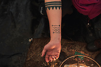 Vanessa Castle shows her water protector tattoo, designed for and by committed camp members on Monday, December 5, 2016. Castle has been entrenched on the land for months and doesn't intend on leaving without a fight.