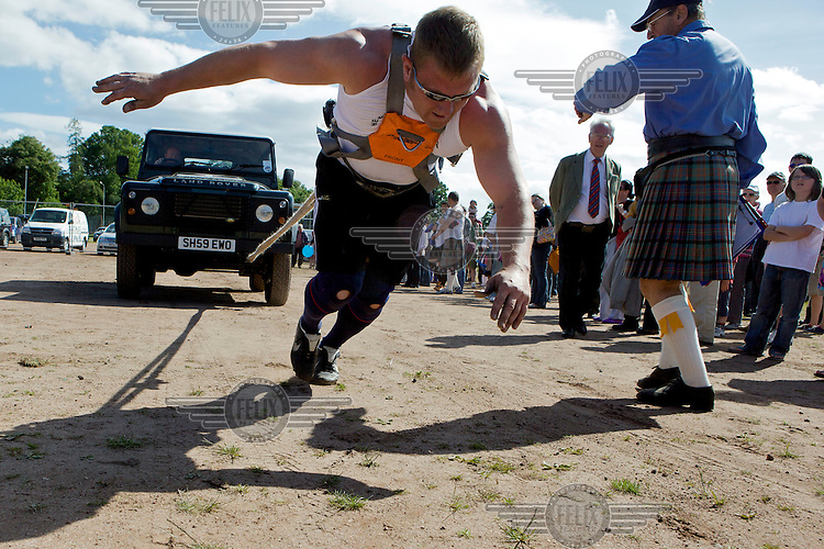 Neil Elliott competes in a car pulling competition at the Helensburgh and Lomond Highland Games in Argyll. Neil competes in over 40 heavyweight events across the world throughout the summer.
