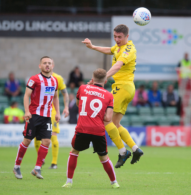 Fleetwood Town's Jordan Rossiter vies for possession with Lincoln City's Joe Morrell<br /> <br /> Photographer Chris Vaughan/CameraSport<br /> <br /> The EFL Sky Bet League One - Lincoln City v Fleetwood Town - Saturday 31st August 2019 - Sincil Bank - Lincoln<br /> <br /> World Copyright © 2019 CameraSport. All rights reserved. 43 Linden Ave. Countesthorpe. Leicester. England. LE8 5PG - Tel: +44 (0) 116 277 4147 - admin@camerasport.com - www.camerasport.com