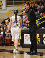 NWA Democrat-Gazette/ANDY SHUPE<br /> Gravette coach Will Pittman speaks to Heather Whitehead against Pottsville Wednesday, Feb. 24, 2016, during the second half of play in the 4A North Regional Tournament in Tiger Arena in Prairie Grove. Visit nwadg.com/photos to see more photographs from the game.