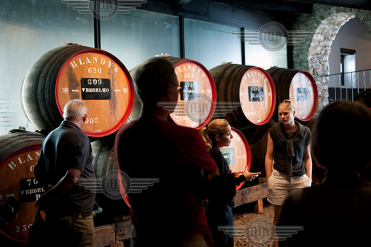 A woman gives a tour of the Old Blandy Wine Lodge in Funchal.