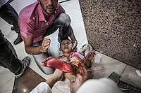 A Syrian child lies down on the floor of a hospital as he gets medical assistance after was wounded by aircraft shelling over a bakery while was buying bread in a residential neighborhood in Aleppo. During last days the Assad's aircraft have targeted bakeries and residential neighborhoods killing daily dozens of civilians in Aleppo City.