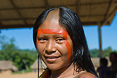 Pará State, Brazil. Aldeia Pukararankre (Kayapo). Smiling woman with urucum and genipapo face paint.