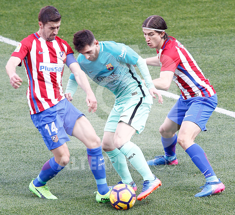 Atletico de Madrid's Gabi Fernandez (l) and Filipe Luis (r) and FC Barcelona's Leo Messi during La Liga match. February 26,2017. (ALTERPHOTOS/Acero)
