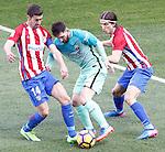 Atletico de Madrid's Gabi Fernandez (l) and Filipe Luis (r) and FC Barcelona's Leo Messi during La Liga match. February 26,2017. (ALTERPHOTOS/Acero)