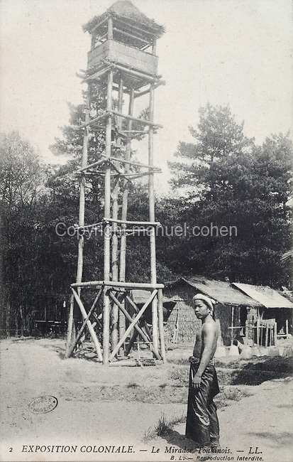 Tonkin lookout tower in the Indochinese Village (French Indochina was a colony 1887-1954), at the Colonial Exhibition of 1907, held in the Jardin d'Agronomie Tropicale, or Garden of Tropical Agronomy, in the Bois de Vincennes in the 12th arrondissement of Paris, postcard from the nearby Musee de Nogent sur Marne, France. The garden was first established in 1899 to conduct agronomical experiments on plants of French colonies. In 1907 it was the site of the Colonial Exhibition and many pavilions were built or relocated here. The garden has since become neglected and many structures overgrown, damaged or destroyed, with most of the tropical vegetation disappeared. The site is listed as a historic monument. Picture by Manuel Cohen / Musee de Nogent sur Marne