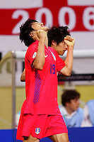 Jae Jin Cho (19) of the Korea Republic reacts after teammate Ji Song Park (7) scored the tying goal.The Korea Republic and France played to a 1-1 tie in their FIFA World Cup Group G match at the Zentralstadion, Leipzig, Germany, June 18, 2006.