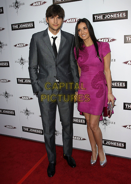 "ASHTON KUTCHER & DEMI MOORE.""The Joneses"" Los Angeles Premieree held At The Arclight Theatres, Hollywood, California, USA..April 8th, 2010.full length grey gray suit tie white shirt pink purple dress embroidered textured silver platform shoes clutch bag married husband wife holding hands hand in pocket.CAP/ADM/KB.©Kevan Brooks/AdMedia/Capital Pictures."