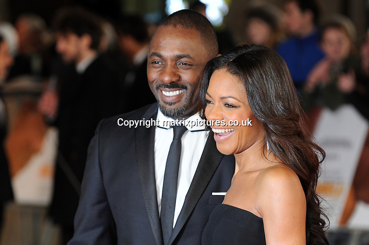 NON EXCLUSIVE PICTURE: PAUL TREADWAY / MATRIXPICTURES.CO.UK<br /> PLEASE CREDIT ALL USES<br /> <br /> WORLD RIGHTS<br /> <br /> British actors Idris Elba and Naomie Harris attend the Royal film performance of &quot;Mandela: Long Walk to Freedom&quot; at the Odeon Theatre at Leicester Square in London, England.<br /> <br /> DECEMBER 5th 2013<br /> <br /> REF: PTY 137771