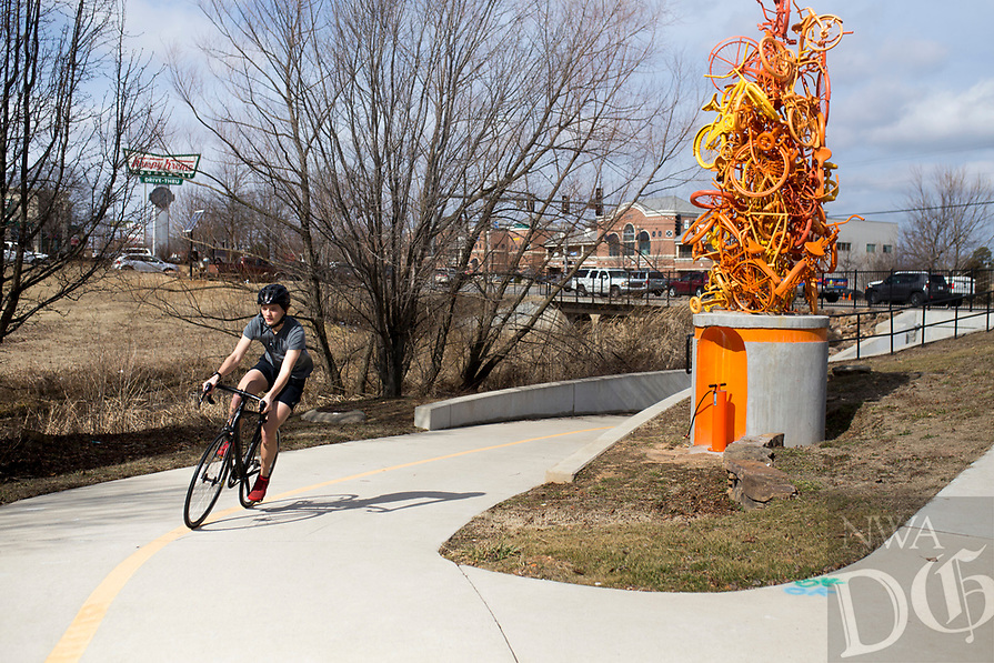 NWA Democrat-Gazette/CHARLIE KAIJO Christian Beasley of Bentonville rides his bike, Thursday, February 15, 2018 at the Razorback Greenway in Bentonville. <br /><br />Benton County leads the state in county health rankings